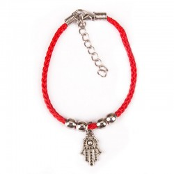 Bracelet on the arm with hanging Hamsa Red thread.