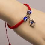 Stylish bracelet on the arm of Hamsa. Souvenir from the Holy Land