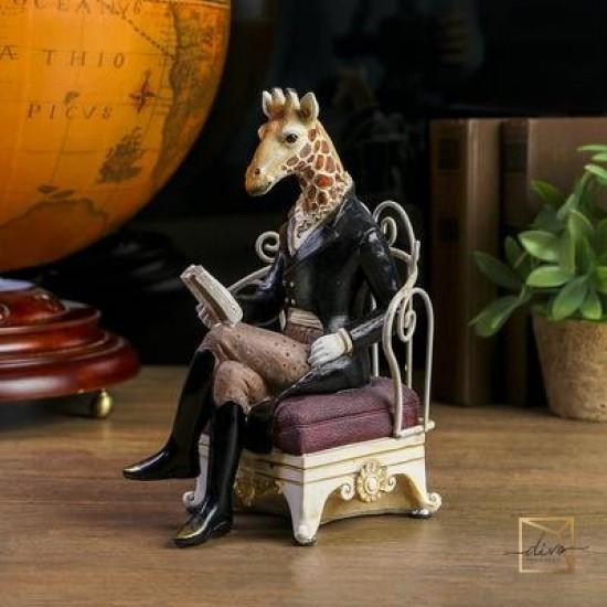 26526719,Souvenir Polistone Giraffe In Komzol In an Armchair With Newspaper 22.5-15-12 cm