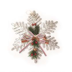 Festive decoration on the Christmas tree snowflake