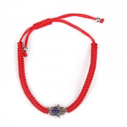 Hand bracelet with hanging Hamsa