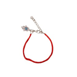 Bracelet on the hand of a simple red thread with Hamsa