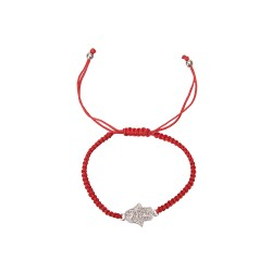 Bracelet on the hand of the red thread with Hamsa
