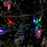Garland on the Christmas tree with colored lights for 180 bulbs
