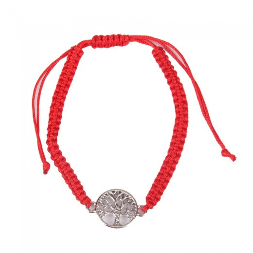Bracelet on hand on a red rope with an extra element of the tree of life