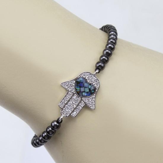 Black hematite bracelet on hand with boors