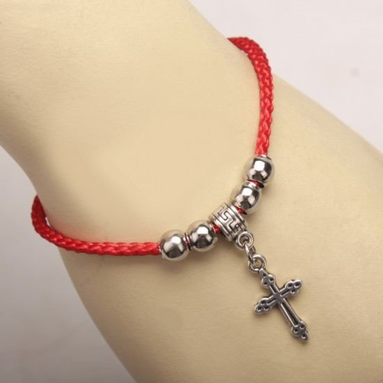 Bracelet on hand with a pendant cross